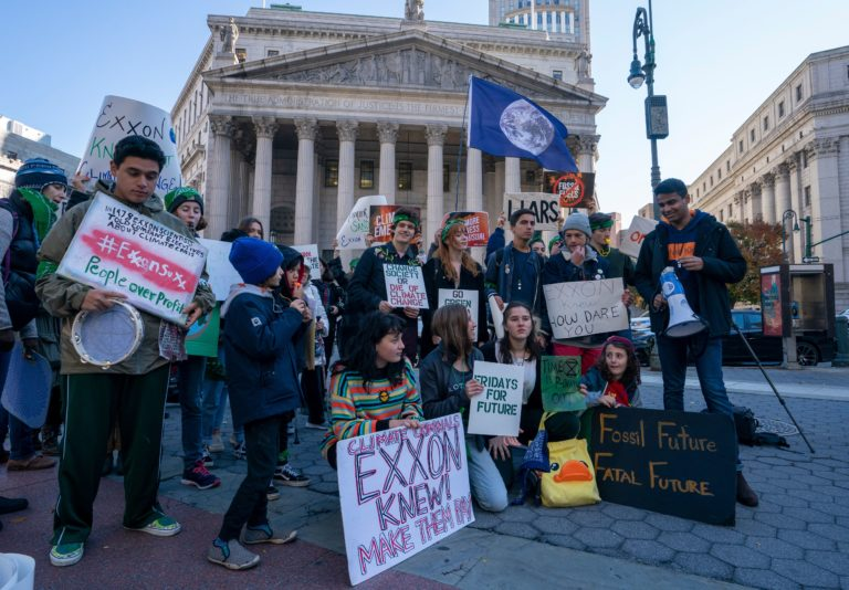 Climate protesters gather in front of Exxon's New York trial
